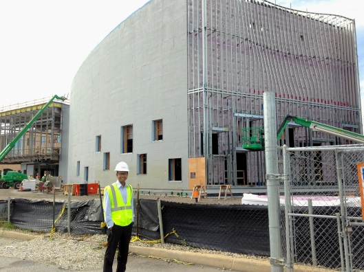 Whiting-Turner intern Kabish Shah stands in front of the second phase of the construction for a performing arts building. Credit: Sonia Su.