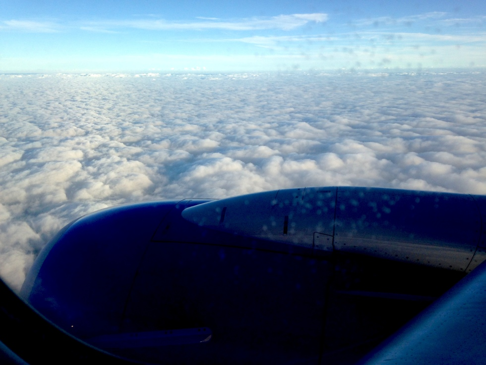 View of fluffy clouds from Southwest airplane