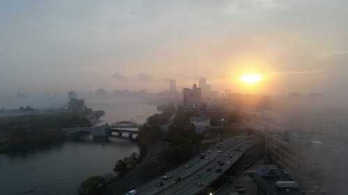 Foggy sunrise over Charles River in Boston
