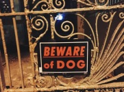 Beware of Dog sign in San Juan