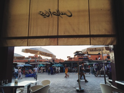 People watching at a café facing Place Jemaa el-Fna