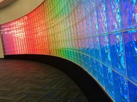 Rainbow-lit wall at Dulles airport