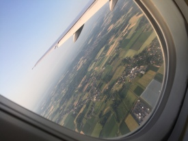 Airplane window view approaching Brussels airport