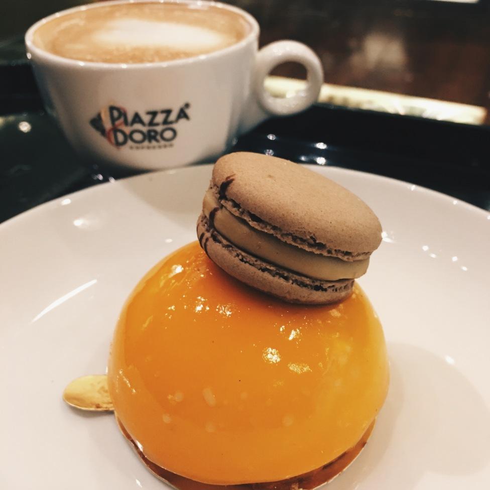 Mango tart with cappuccino from Garden Hotel lobby café