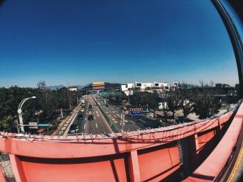 Walking across pedestrian bridge to Taipei Fine Arts Museum from Expo Park