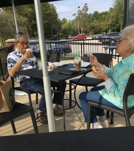 Cute old couple outside Starbucks
