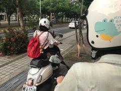 Riding motorbikes to dinner.