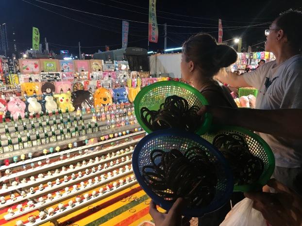 Playing games at Huayuan Night Market in Tainan