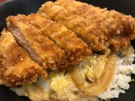 Yummy fried chicken cutlet over eggs and rice.